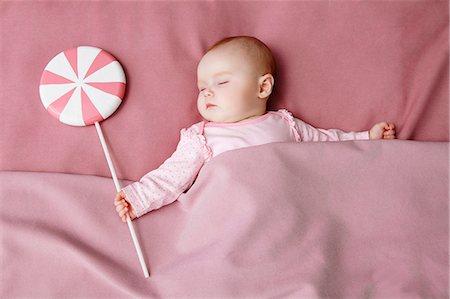 Baby girl sleeping in bed Stock Photo - Premium Royalty-Free, Code: 649-06717438