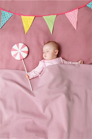 sweet - Baby girl sleeping in bed Stock Photo - Premium Royalty-Free, Code: 649-06717439