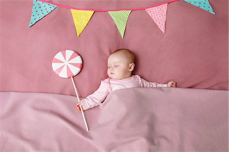 Baby girl sleeping in bed Stock Photo - Premium Royalty-Free, Code: 649-06717440