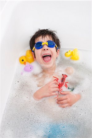 Boy in snorkel mask laughing in bath Stock Photo - Premium Royalty-Free, Code: 649-06717469