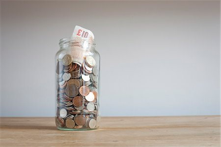 Savings jar on desk Stock Photo - Premium Royalty-Free, Code: 649-06717471