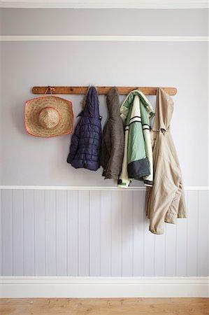 Coats and hat on coat rack Stock Photo - Premium Royalty-Free, Code: 649-06717496