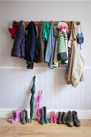 Coats on coat rack with boots Stock Photo - Premium Royalty-Free, Code: 649-06717497