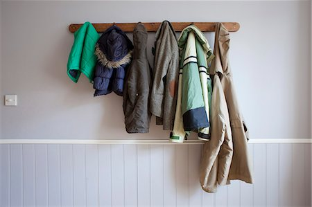 dangling - Coats hanging on coat rack Stock Photo - Premium Royalty-Free, Code: 649-06717498