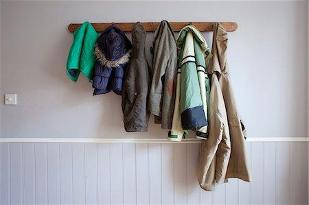 Coats hanging on coat rack Stock Photo - Premium Royalty-Free, Code: 649-06717498