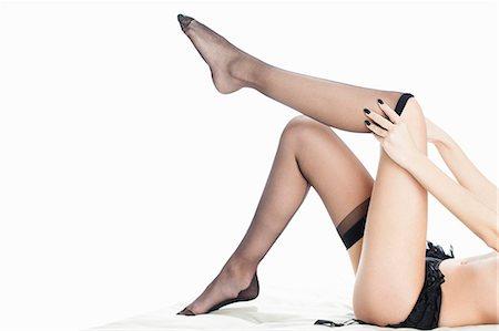 Woman pulling down stockings Stock Photo - Premium Royalty-Free, Code: 649-06717500