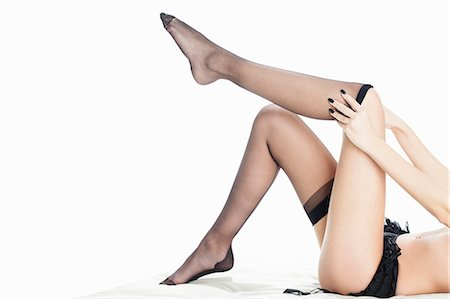 Woman pulling down stockings Stock Photo - Premium Royalty-Free, Code: 649-06717500