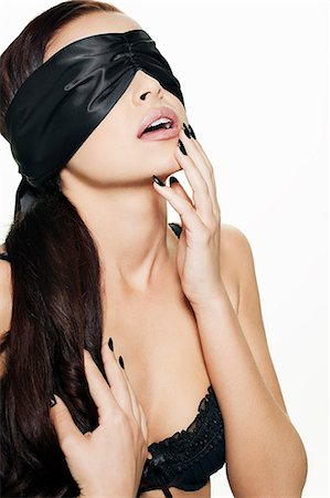 desire - Woman in lingerie wearing blindfold Stock Photo - Premium Royalty-Free, Code: 649-06717519