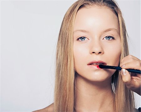 Woman having makeup applied Stock Photo - Premium Royalty-Free, Code: 649-06717533