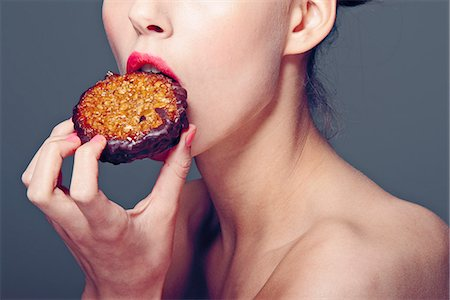 sexy - Woman eating cookie Stock Photo - Premium Royalty-Free, Code: 649-06717554