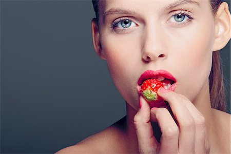 desire - Woman eating strawberry Stock Photo - Premium Royalty-Free, Code: 649-06717551