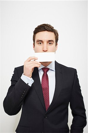 dece11 - Businessman holding blank card over his face Stock Photo - Premium Royalty-Free, Code: 649-06717568