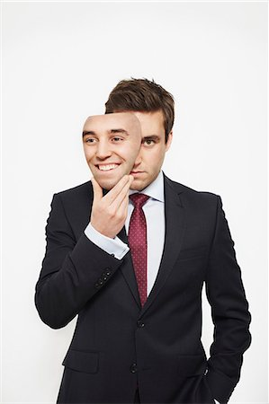 dece11 - Businessman holding mask over his face Stock Photo - Premium Royalty-Free, Code: 649-06717569