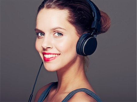 Smiling woman wearing headphones Stock Photo - Premium Royalty-Free, Code: 649-06717560