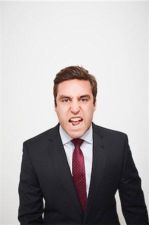 Businessman yelling indoors Stock Photo - Premium Royalty-Free, Code: 649-06717563