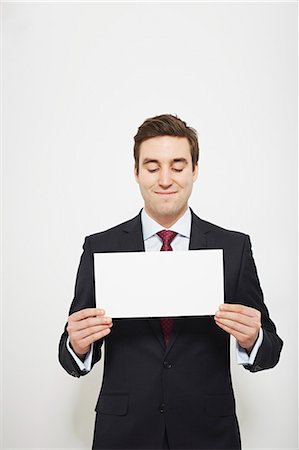 displaying - Businessman holding blank card Stock Photo - Premium Royalty-Free, Code: 649-06717570