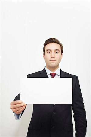 displaying - Businessman holding blank card Stock Photo - Premium Royalty-Free, Code: 649-06717571