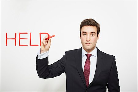 person overwhelmed stresss - Businessman writing 'help in air Stock Photo - Premium Royalty-Free, Code: 649-06717572
