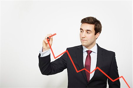Businessman drawing graph in air Stock Photo - Premium Royalty-Free, Code: 649-06717573