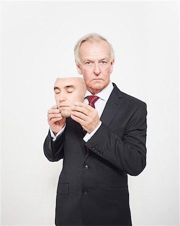 person silhouette face - Businessman holding mask Stock Photo - Premium Royalty-Free, Code: 649-06717588