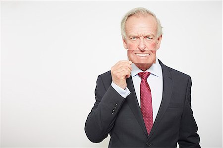 dece11 - Businessman holding picture over his mouth Stock Photo - Premium Royalty-Free, Code: 649-06717594