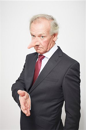 dece11 - Businessman with long nose offering hand Stock Photo - Premium Royalty-Free, Code: 649-06717599