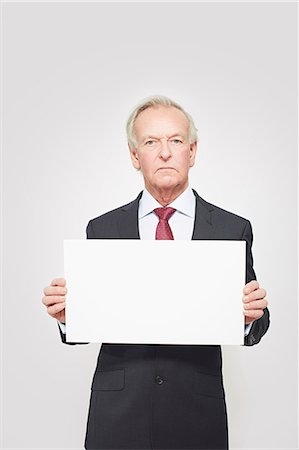 sign - Businessman holding blank card Stock Photo - Premium Royalty-Free, Code: 649-06717593