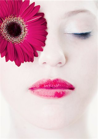 Close up of womans face with flower Stock Photo - Premium Royalty-Free, Code: 649-06717618