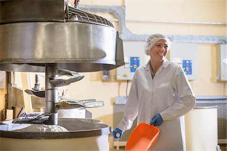 food processing plant - Worker with machinery in biscuit factory Stock Photo - Premium Royalty-Free, Code: 649-06717641