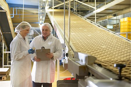 food processing plant - Workers talking in biscuit factory Stock Photo - Premium Royalty-Free, Code: 649-06717662