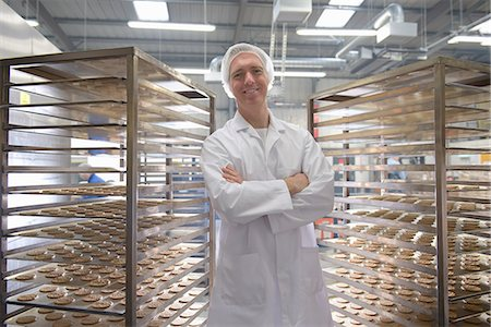 Worker baking biscuits in factory Stock Photo - Premium Royalty-Free, Code: 649-06717686