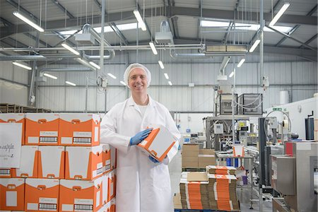 food processing plant - Worker smiling in biscuit factory Stock Photo - Premium Royalty-Free, Code: 649-06717697