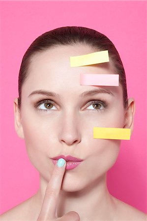 remembered - Woman with sticky notes on face Stock Photo - Premium Royalty-Free, Code: 649-06717829