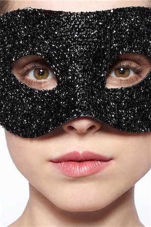 Woman wearing glitter mask over eyes Stock Photo - Premium Royalty-Free, Code: 649-06717848
