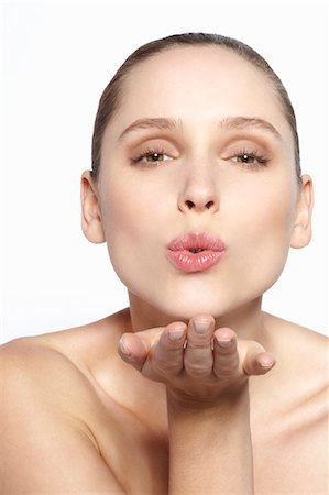 Close up of woman blowing a kiss Stock Photo - Premium Royalty-Free, Code: 649-06717842