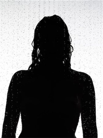 Silhouette of woman in shower Stock Photo - Premium Royalty-Free, Code: 649-06717895