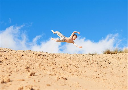 Boy jumping on beach Stock Photo - Premium Royalty-Free, Code: 649-06812028