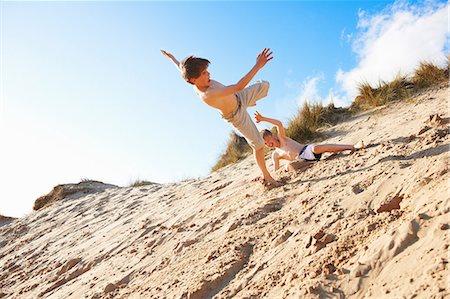 preteen boy shirtless - Two boys playing on beach Stock Photo - Premium Royalty-Free, Code: 649-06812038