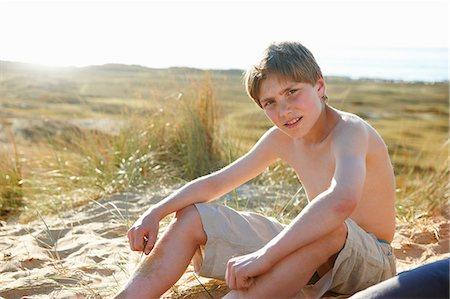 preteen boy shirtless - Boy sitting on beach Stock Photo - Premium Royalty-Free, Code: 649-06812045