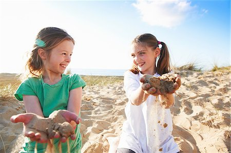 pre-teen beach - Two girls playing with sand Stock Photo - Premium Royalty-Free, Code: 649-06812051