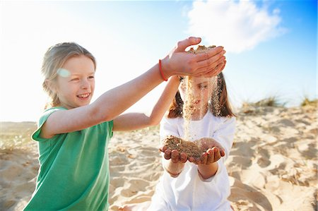 Two girls playing with sand Stock Photo - Premium Royalty-Free, Code: 649-06812052