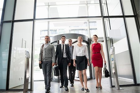 Group of business people walking into glass office building Stock Photo - Premium Royalty-Free, Code: 649-06812108