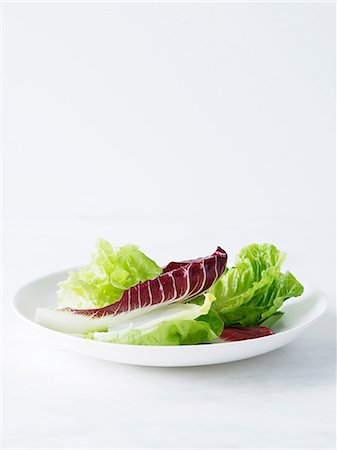 salad - Mixed salad leaves on white plate Stock Photo - Premium Royalty-Free, Code: 649-06812177