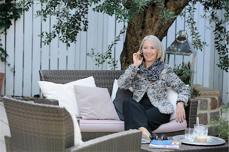 Senior woman on cellphone in garden Stock Photo - Premium Royalty-Free, Code: 649-06812366