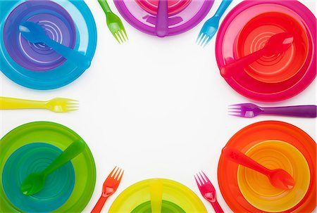 Colourful plastic plates, cups, bowls, spoons and forks Stock Photo - Premium Royalty-Free, Code: 649-06812402