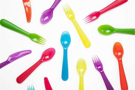 rainbow - Colourful plastic knives, forks, spoons Stock Photo - Premium Royalty-Free, Code: 649-06812412