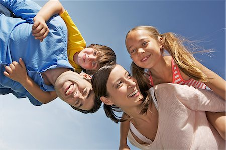 Portrait of family with two children from below Stock Photo - Premium Royalty-Free, Code: 649-06812440
