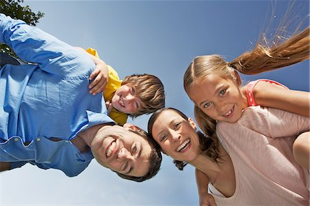 Portrait of family with two children from below Stock Photo - Premium Royalty-Free, Code: 649-06812441