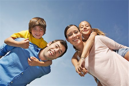 Portrait of family with two children from below Stock Photo - Premium Royalty-Free, Code: 649-06812442