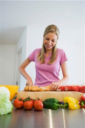 Young woman preparing food Stock Photo - Premium Royalty-Free, Code: 649-06812517